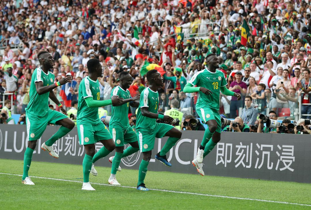MOSCOW, RUSSIA - JUNE 19:  Mbaye Niang of Senegal celebrates with teammates after scoring his team's second goal during the 2018 FIFA World Cup Russia group H match between Poland and Senegal at Spartak Stadium on June 19, 2018 in Moscow, Russia.  (Photo by Catherine Ivill/Getty Images)