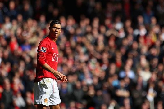 MANCHESTER, UNITED KINGDOM - MARCH 14: Cristiano Ronaldo of Manchester United looks on during the Barclays Premier League match between Manchester United and Liverpool at Old Trafford on March 14, 2009 in Manchester, England. (Photo by Laurence Griffiths/Getty Images)